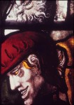 Fig. 5. Galyon Hone (attributed), 'Soldier watching dice below the Cross', stained and painted glass, c.1540. Main-light panel (detail) in the east window of the choir, King's College Chapel, Cambridge