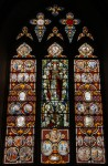 Fig. 3. East window at Preston-on-Stour (Warwickshire), dated 1754 at bottom of centre light. The Christ in Glory was inserted in 1904, displacing West's coat of arms and a 'sheckinah' (the Hebrew name of God in a burst of light). © Geoffrey Lane