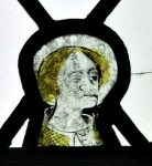 One of the few remaining fragments of medieval glass in St Cuthbert's: south aisle, west window, tracery light. © Roger Rosewell