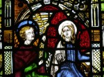 The Virgin Mary as depicted in the Annunciation in the east window of the north aisle