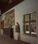 Fig. 5. View of the newly opened window at The Cloisters exhibiting the Adoration of the Magi (Munich, 1507) and a Circumcision (Cologne, 1460-70) © The Metropolitan Museum of Art