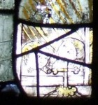 Fig. 3. Detail of two souls peering from a window, Thornhill Church, West Yorkshire, © J. Allen.
