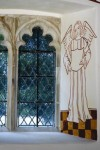 Fig. 4. North aisle window splay with a recreated wall painting of an angel. © St Fagans: National History Museum.