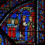 Fig. 4. Constantine offers Charlemagne relics that include the Sancta Camisa draped over cases housing other relics, Chartres cathedral. © Painton Cowen.
