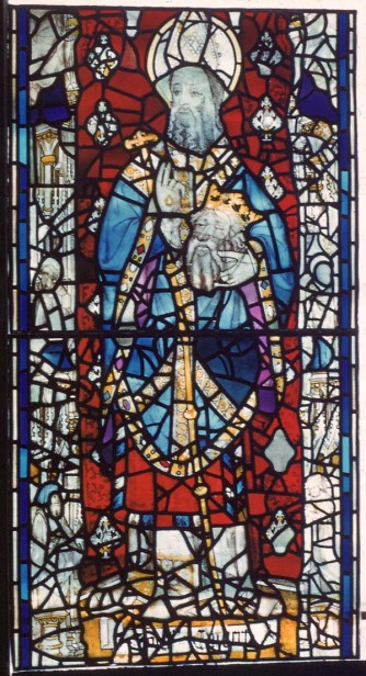 St Cuthbert holding St Oswald's head. Panel 4c, sVII, St Cuthbert window, York Minster. © Crown Copyright, NMR.