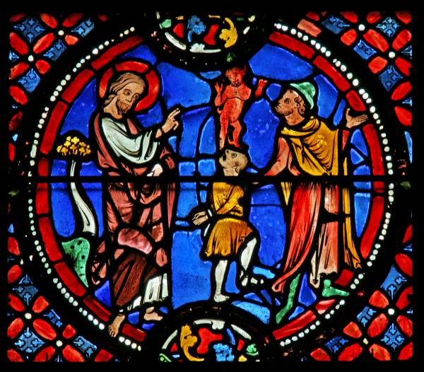 St. Andrew exorcises a demon from a possessed youth. © Painton Cowen.