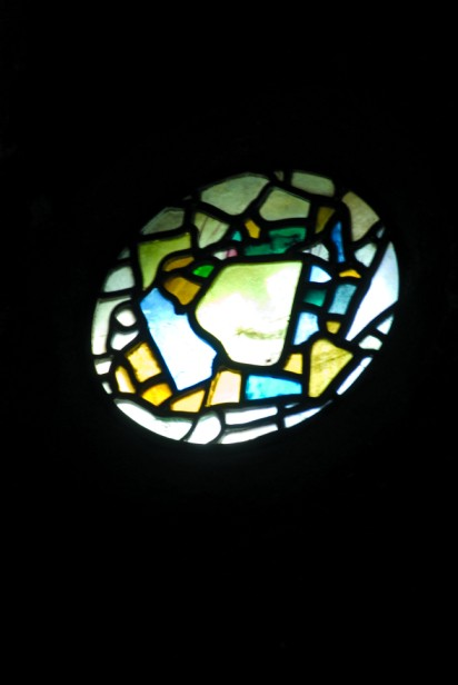 Mosaic of coloured glass set in a small 7th-century circular window (sIII) at St Paul's church, Jarrow. © Bede's World Museum