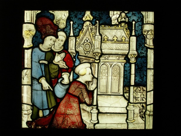 A woman kneels at the tomb, St William window. © Dean and Chapter of York.