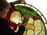 Alison Gilchrist with a William Morris panel from the church of St Martin on the Hill, Scarborough. © Barley Studio.