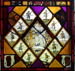 Gamul/Poole armorial surrounded by quarries depicting soldiers practising drill, from Poole Hall. © the author.