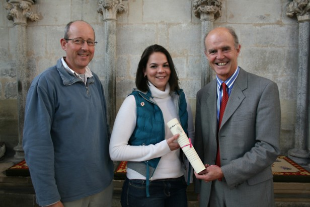 Vicky Burton receives her formal document marking the end of her four year apprenticeship at Salisbury Cathedral from Mark Elcomb (R) watched by Sam Kelly (L) in the Chapter House at Salisbury Cathedral.