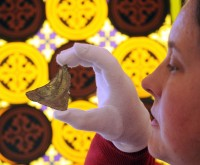 Curator Susan Harrison examines the abbey glass © English Heritage