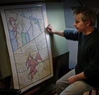 Jonathan Cooke working on the cartoon.