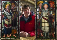 Fig. 4. Dr Rick Turner with the two panels © Cadw, reproduced with permission