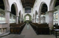 Fig. 1. Church of St Peter, Lowick looking east. Jesse Tree panels in the north aisle.