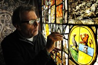 Fig. 1. Keith Barley at work on sixteenth-century glass from the Beaney Institute, Canterbury. (c) Rob Scott Photography