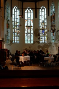 Fig. 5. Delegates enjoying lunch in Schermerhorn, De Grote Kerk. © Nick Teed