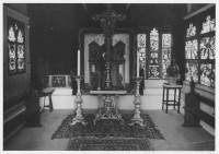 Fig. 2. Interior of the Oratory of the Angels, Abbey Folk Park, showing in the window to the right of the altar the final ten panels acquired by Ward from Winchester Cathedral. To the right of this are six of the Winchester panels from the earlier acquisitions. (Photograph: Michael Scott; reproduced with permission of the Abbey Museum of Art and Archaeology)