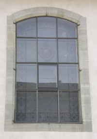 Fig. 3. Protective glazing at the Église des Capucins, Romont, c.1950. This kind of protective glazing usually consists of single-pane glazing fitted in a light metal or wooden frame. The frame of this 'storm window' is fixed to the masonry adjoining the window and is therefore structurally unconnected to the stained glass. The interspace between the stained glass window and the protective glazing is usually unventilated and ranges between 5 and 30 cm, depending on the width of the window reveal.
