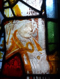 Fig. 5. Glynneath, St Cadoc, east window: detail of window XII panel 1a, the lower portion of the donor's clothing replaced. (Katie Harrison)