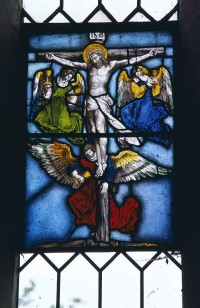 Fig. 2. The Crucifixion with angels collecting Christ's blood, C16, from a window in the west tower of St Mary's Church, Stradsett