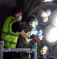 Fig. 1. A tracery panel being installed by a member of the Barley Studio team.