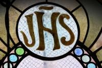 Fig. 8. Vallgorguina, private chapel: rose window in the façade, monogram of Jesus.
