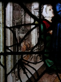 Fig. 2. Cour-sur-Loire, window 5, legend of the pilgrims of St James, detail of scene number 1 (actually number 5 according to the legend): the miracle of the fowls, detail of the fireplace and the maidservant's gesture.