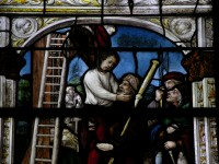 Fig. 3. Cour-sur-Loire, window 5, legend of the pilgrims of St James, detail of scene number 5 (actually number 3 according to the legend): the young pilgrim is hanged by the neck, with medallions of Roman emperors.