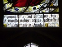 Fig. 18. Ludlow, St Laurence, St John's Chapel, the Lord's Prayer (Paternoster) and the Salutation (Ave Maria) window: detail showing a section of the Lord's Prayer. © Author