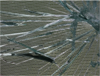 Fig. 8. Polyester Stabiltex and Paraloid B72. Note that the model glass is much clearer than any examples of LLGD would be, and so the weave of the fabric is more visible.