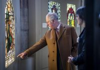 Fig. 1. HRH the Prince of Wales examines a window in the Stained Glass Museum's gallery with the museum's curator, Dr Jasmine Allen.