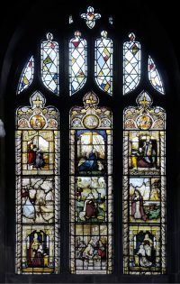 Fig. 7. A collection of Netherlandish panels and roundels, mostly sixteenth-century in date, containing an inscription commemorating Revd. W. G. Rowland, responsible for bringing together the spectacular glass at St Mary's (Photo: Gordon Plumb).